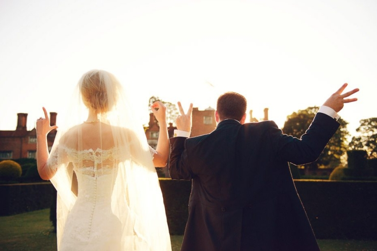 A fabulous Great Fosters bride and groom at sunset.