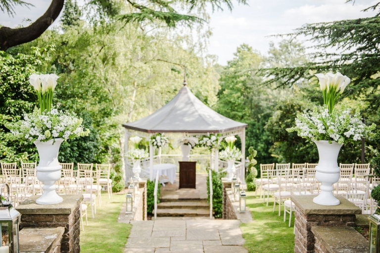 Elegant outdoor pavilion decorated with white lilies and stocks for a same sex Summer wedding in Surrey.