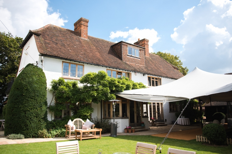 Luxury Berkshire home wedding day with comfy cushions and sun and rain canopy.
