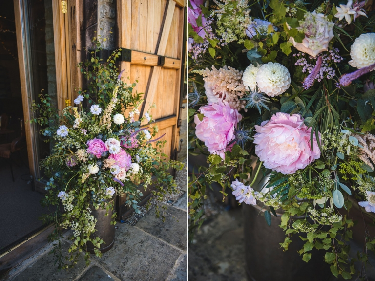 Herbert And Isles rustic wedding flowers in old milk churns.