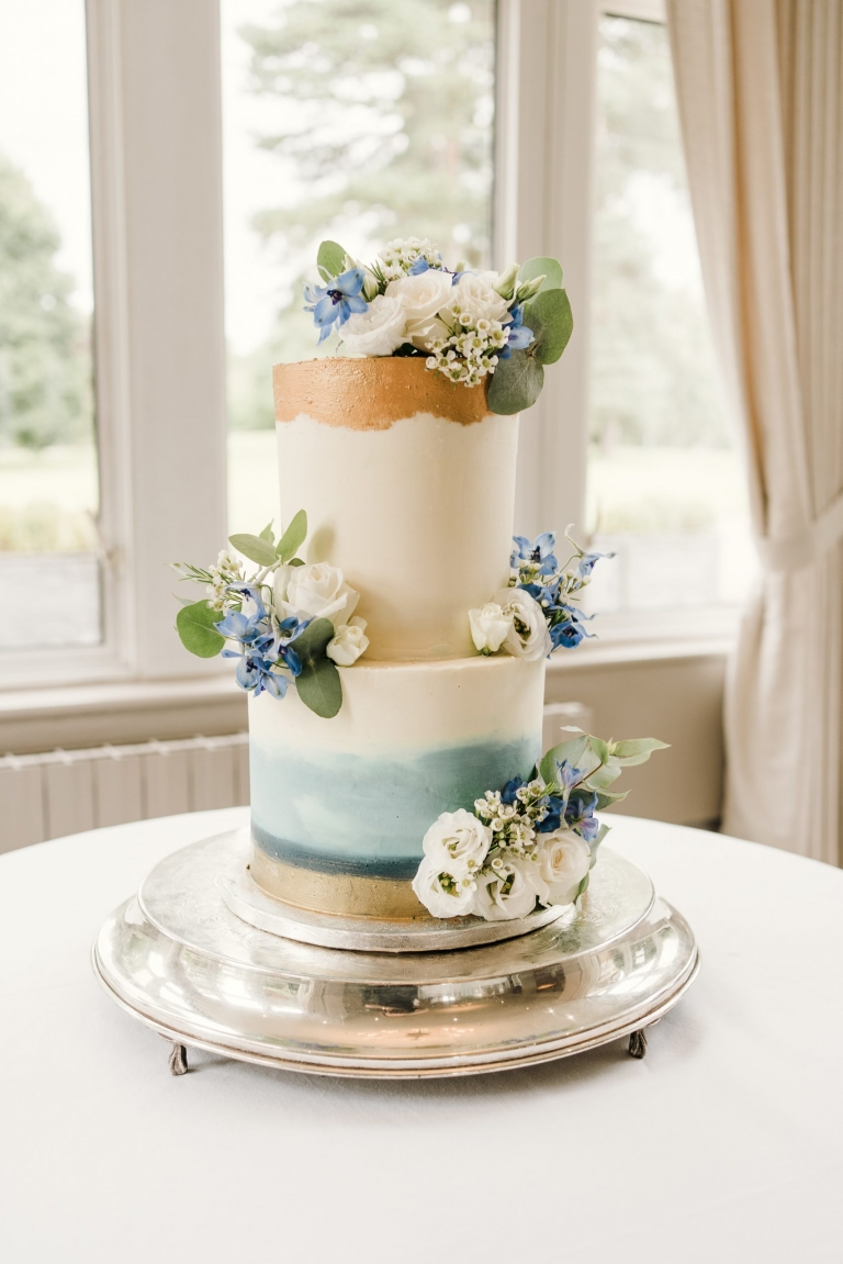 Hand painted cake for a blue themed wedding.