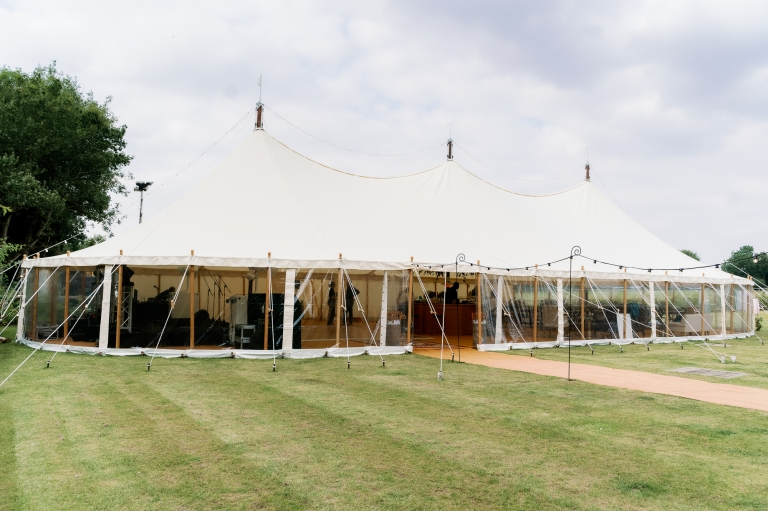 Peacock & Bow marquee at a Hertfordshire marquee wedding photographed by Juliet Mckee Photography.